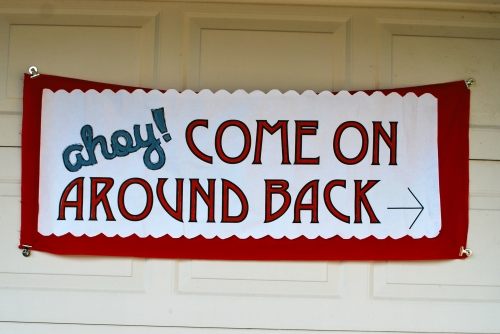 We hung this sign up on the garage door that directed guests to go around the side of the house to the back yard.