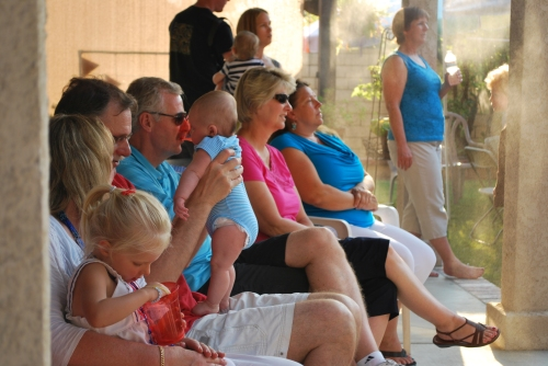 It was a very hot day, so several of the guest lined up under the misters to cool off and watch the gifts be opened.