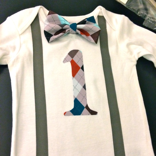 I made this shirt for Harry.  I used some iron on bonding to adhere the ribbon suspenders and the one.  The bow tie I glued on with a hot glue gun.
