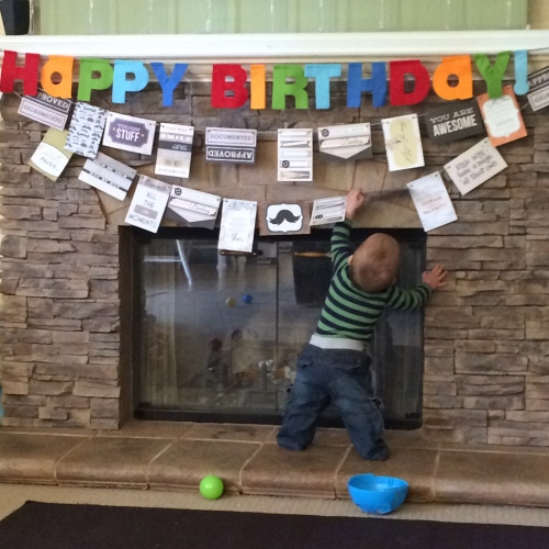 While most of the party was outside, I did put up some decorations inside as well.  I found some cute 4x6 card packs on sale in the scrapbooking section of Hobby Lobby.  I punched holes and threaded them with yarn to make the banner.  Harry liked them.